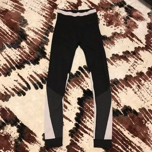 Alala black tights with pink accents